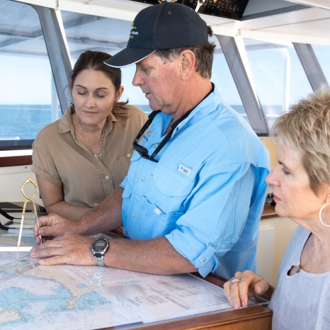 kimberley pearl captain in cabin looking at map